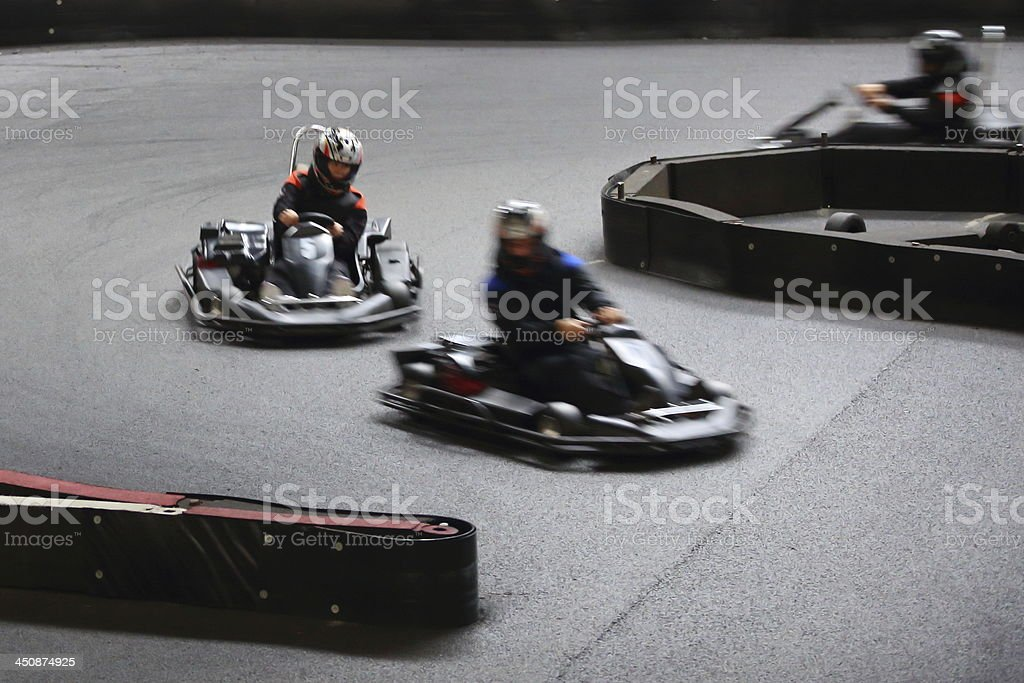 Blurred-view of an indoor go cart race stock photo
