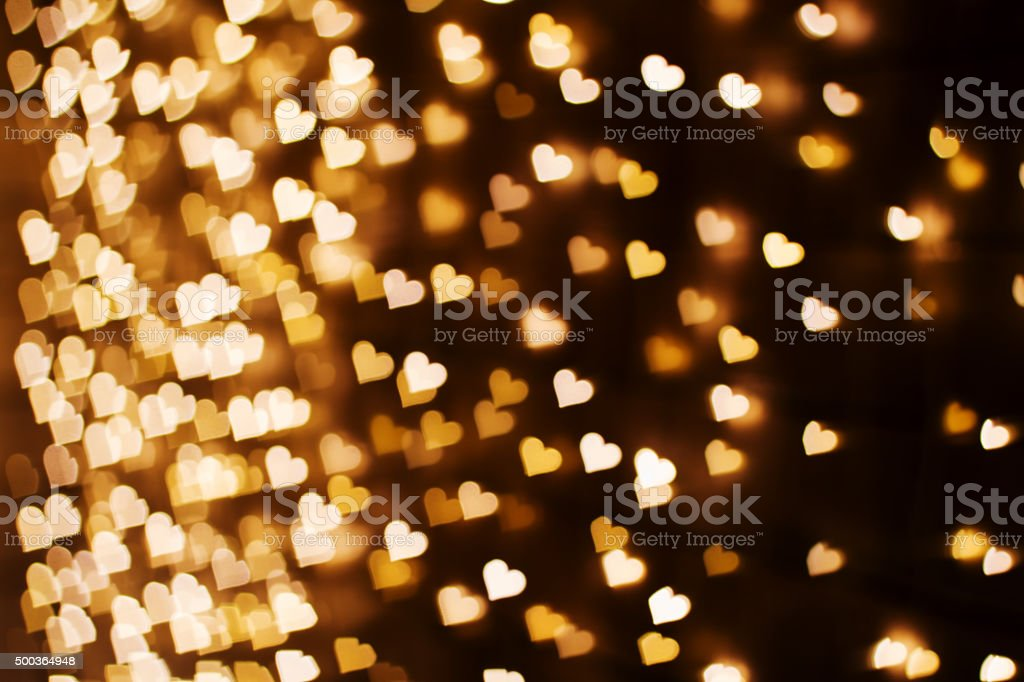 Blurring lights bokeh background of hearts stock photo