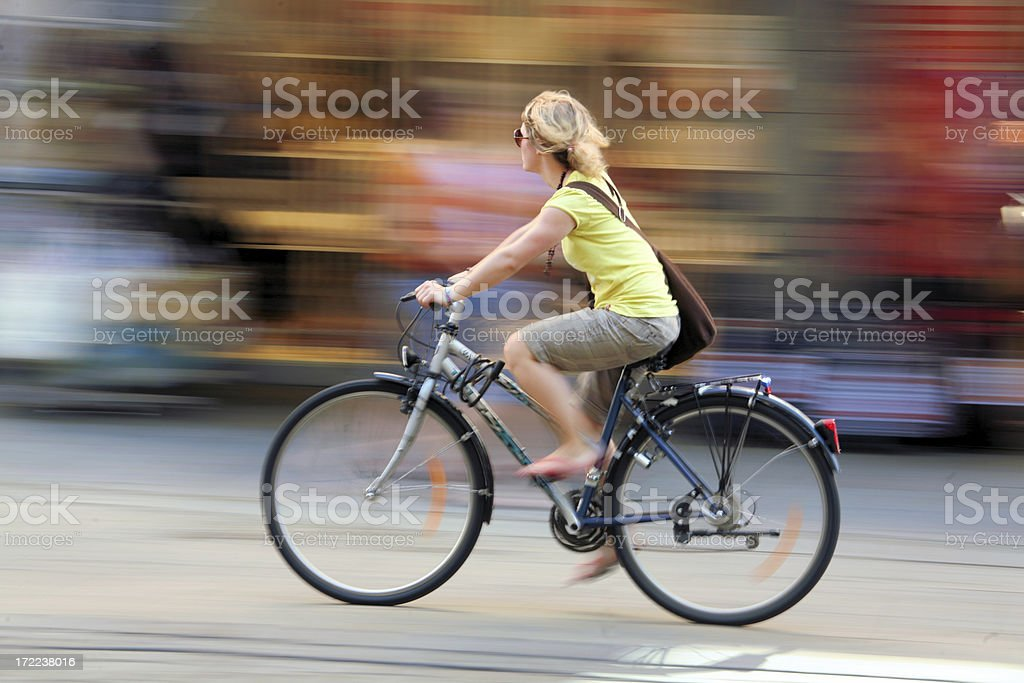 Blurry background of a woman on a bicycle stock photo