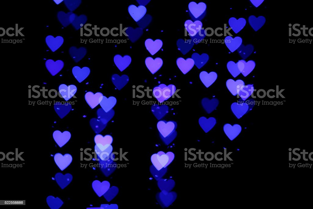 Blurry blue lights in heart shape stock photo