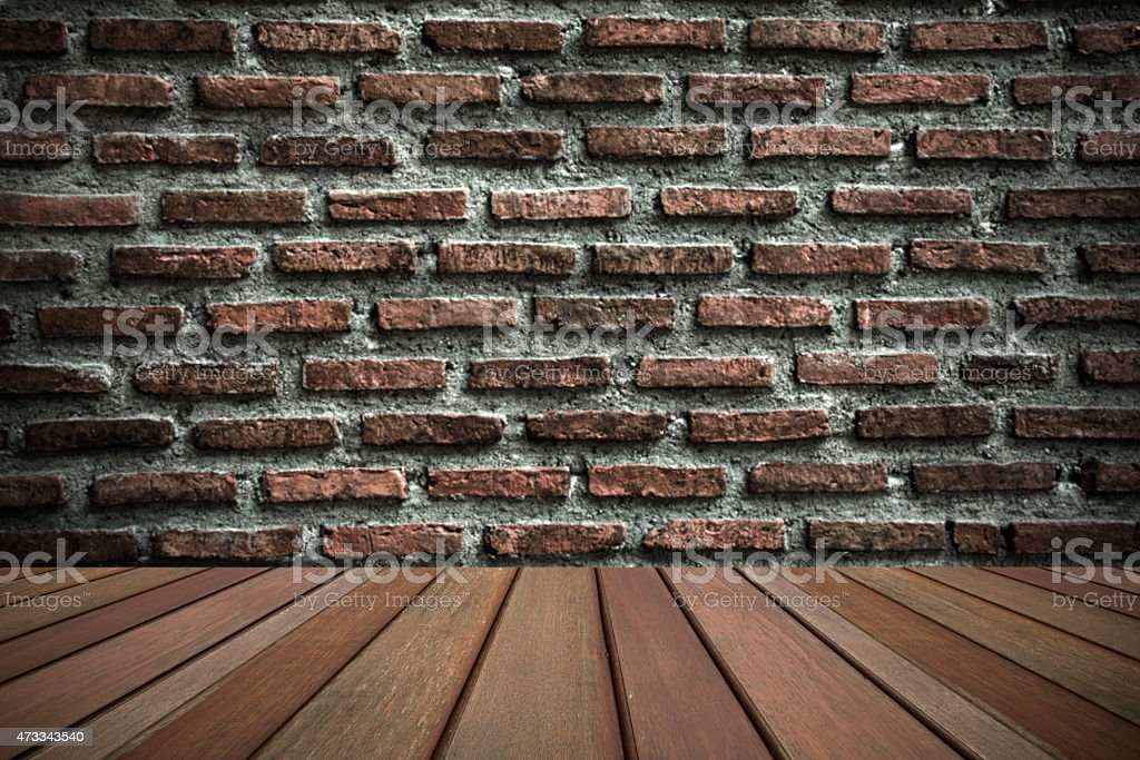 Blurry brick wall and wooden floor royalty-free stock photo