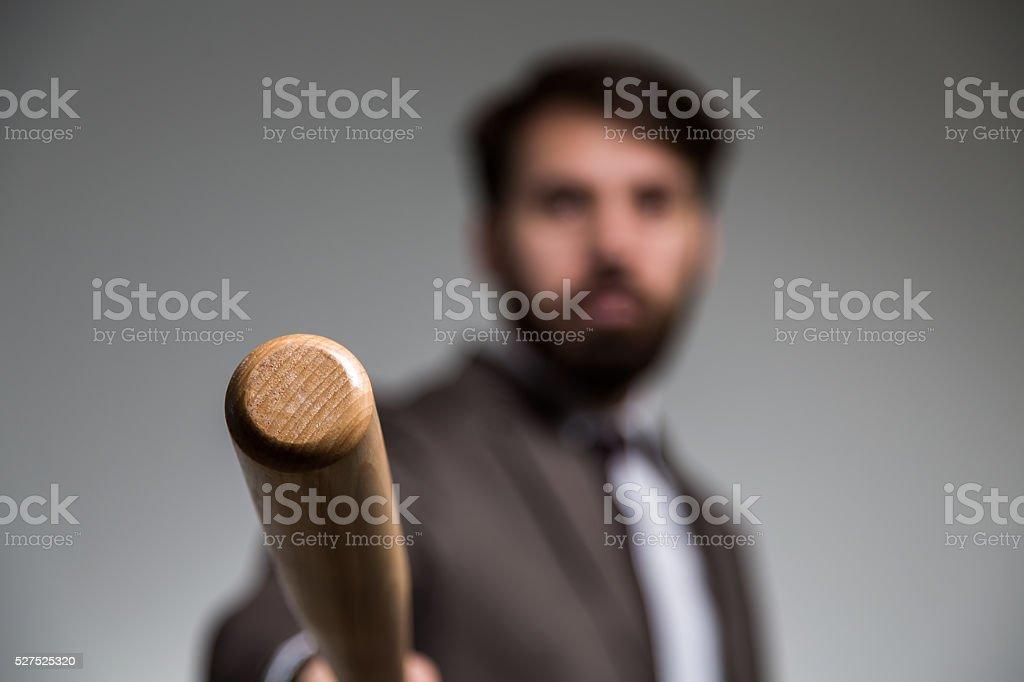 Blurry businessman and bat stock photo