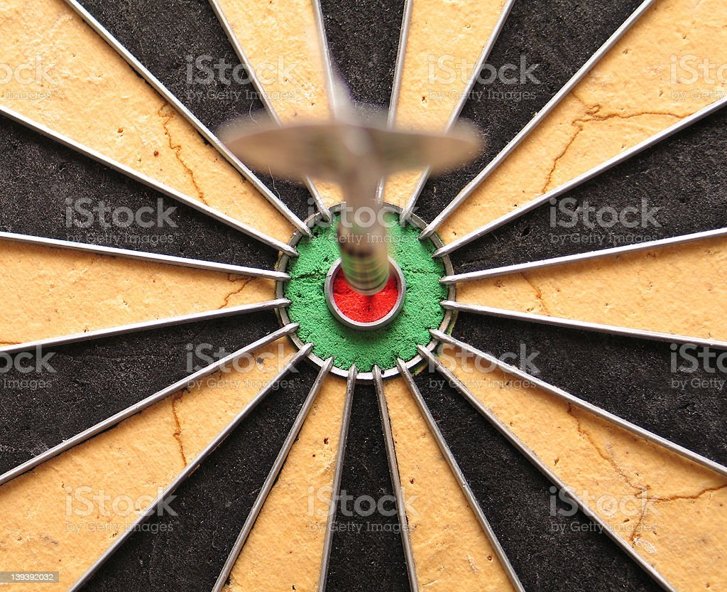 Blurry dart on clear bullseye dartboard royalty-free stock photo