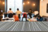 blurry defocused image of people working in cafe