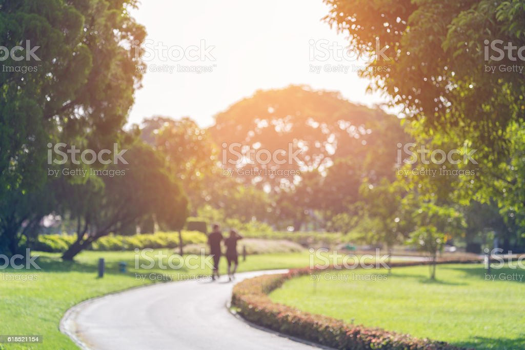 Blurry focus scene of people in public park stock photo