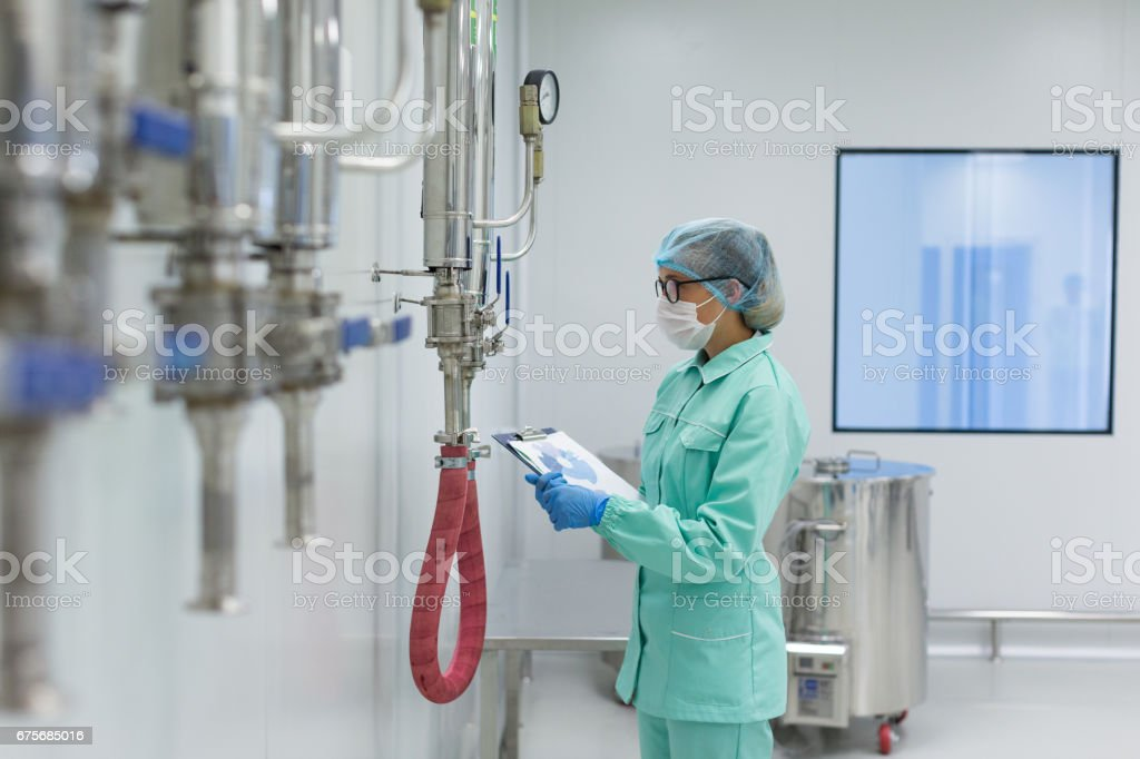 blurry front picture, industrial worker check readings stock photo
