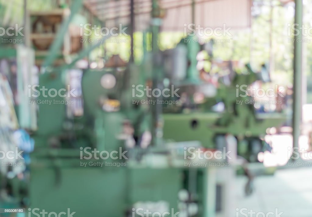 blurry image of a lathe machine stock photo