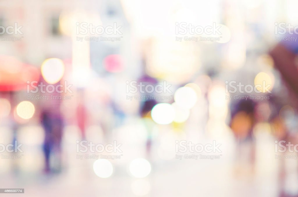 A blurry image of a street of people stock photo