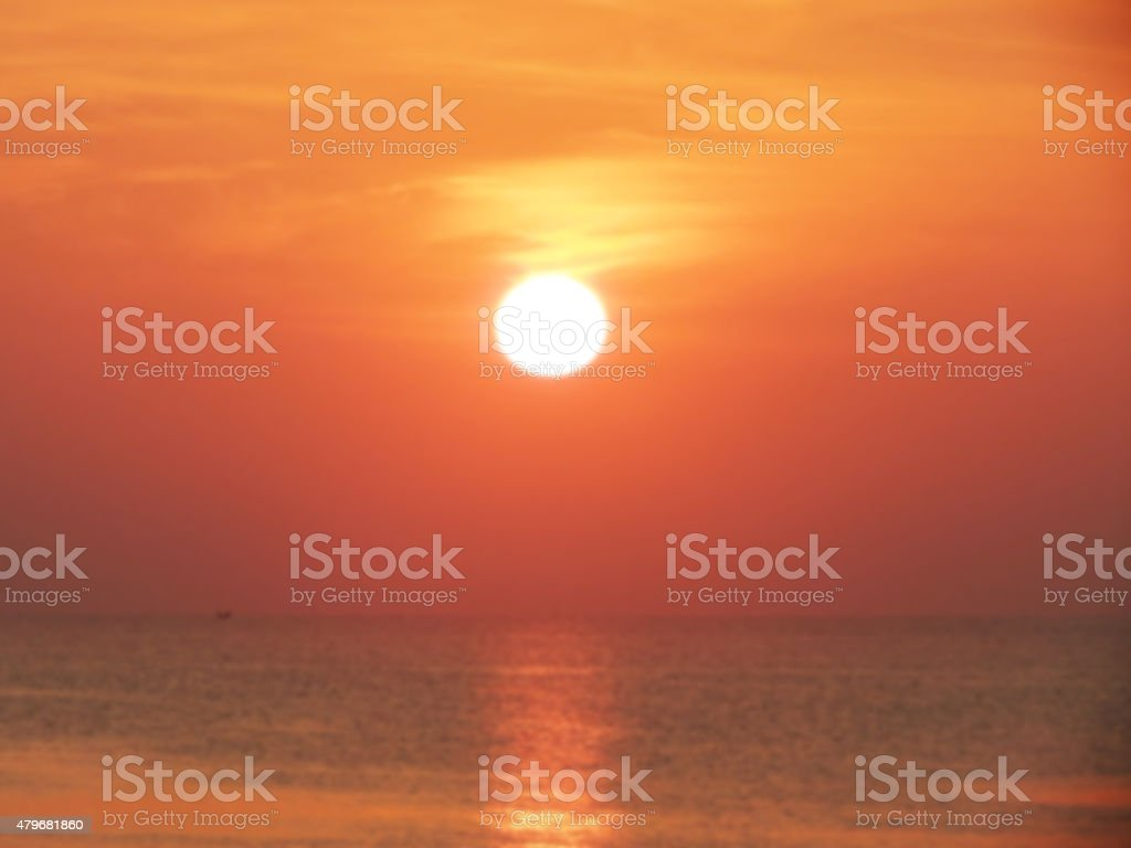 Blurry image. Sun setting on the  Ocean royalty-free stock photo