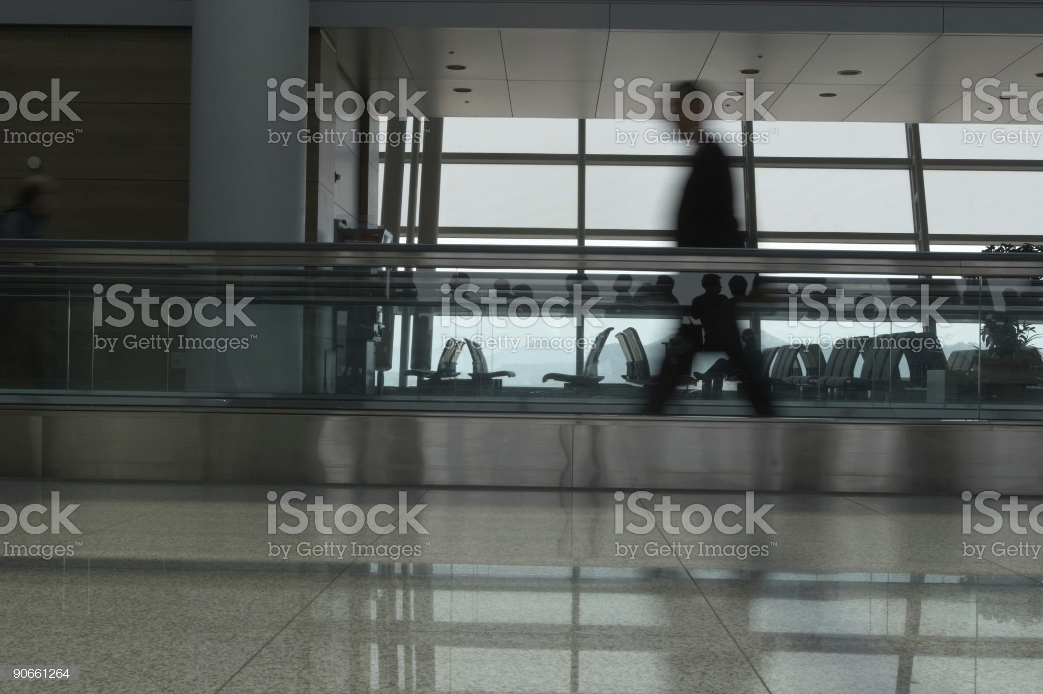 Blurry man walking with silhouettes royalty-free stock photo