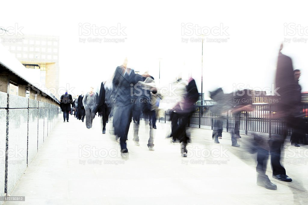 Blurry motion shot of business people walking on street. royalty-free stock photo