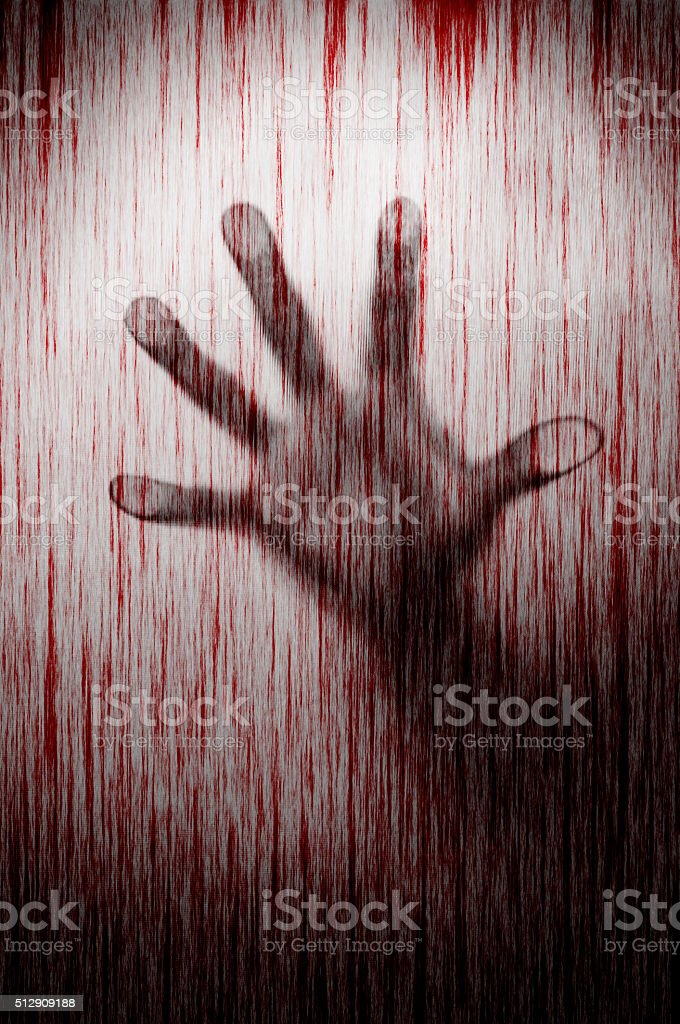Blurry murderer hand behind matted glass with blood stain murder stock photo