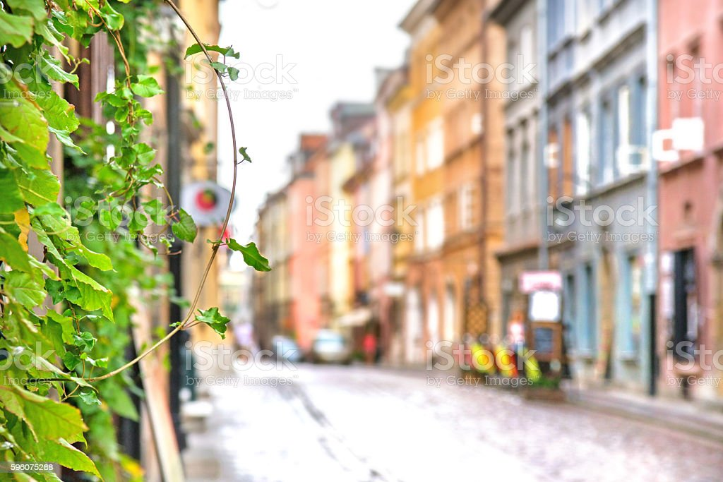 Blurry old street of European city in Summer stock photo
