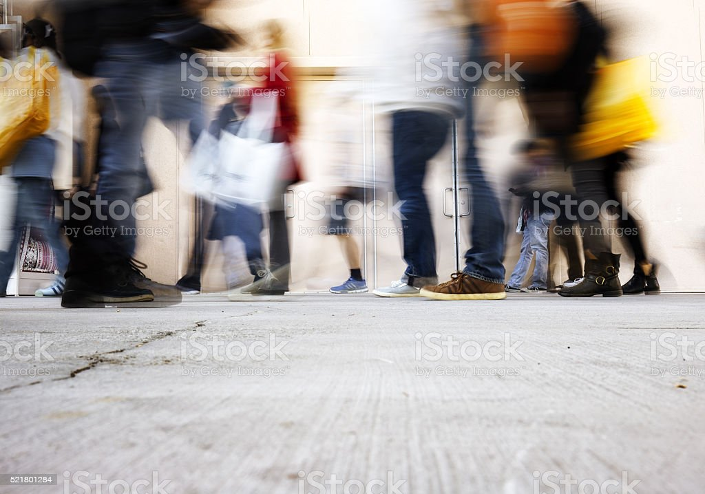 blurry people walking on the sidewalk at rush hour stock photo