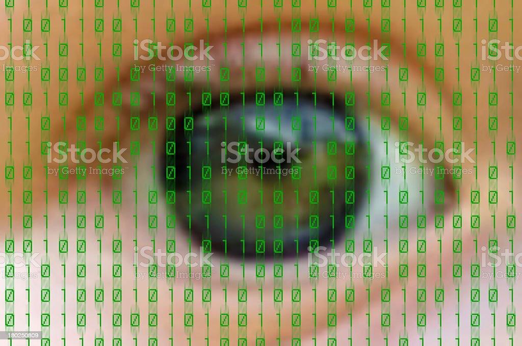 Blurry shot of eye overlaid with binary code stock photo