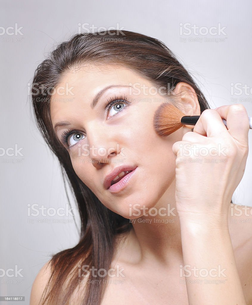 Blushing her lovely cheeks royalty-free stock photo