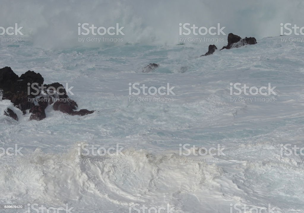 Blustering surf at a rocky coast stock photo