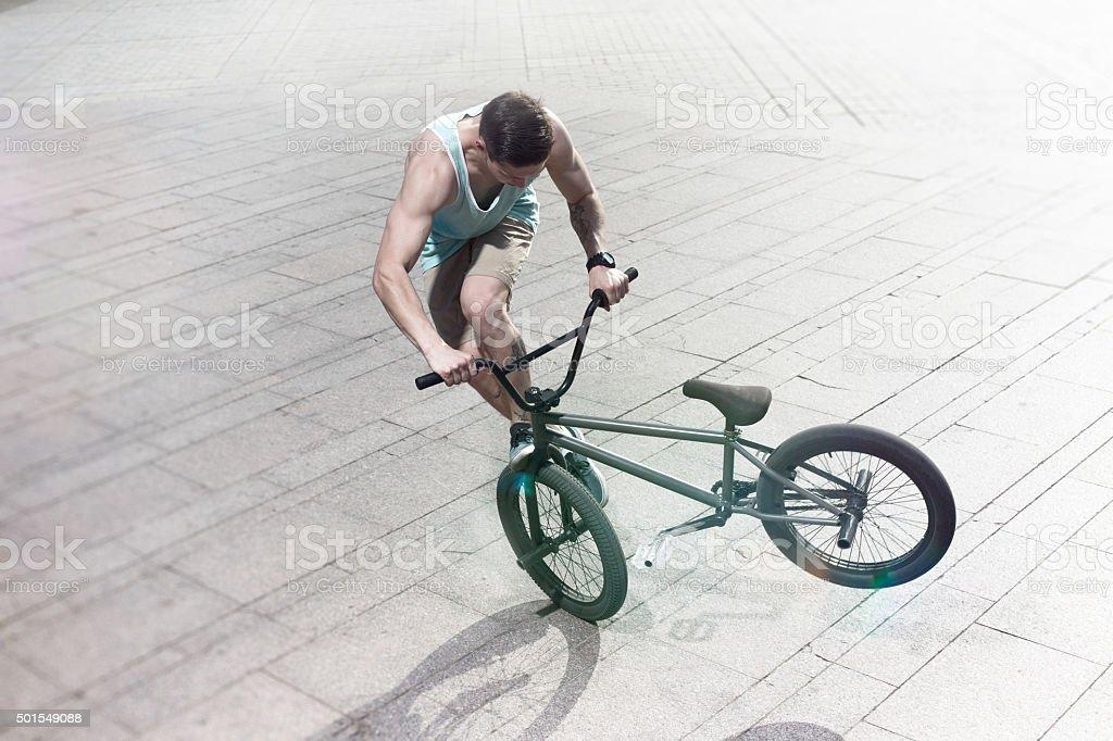 bmx bike rider on the highlights stock photo