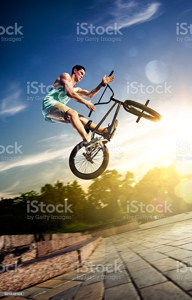 bmx bike rider on the highlights stock photo