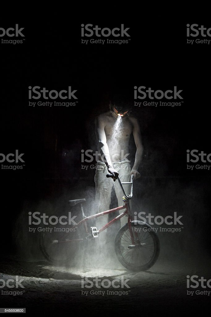 boy performing stunts with bike