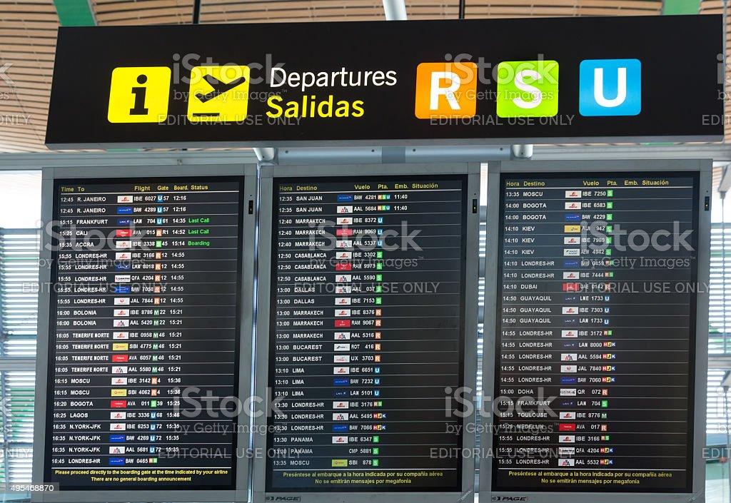 Board departures in Madrid Barajas Airport stock photo