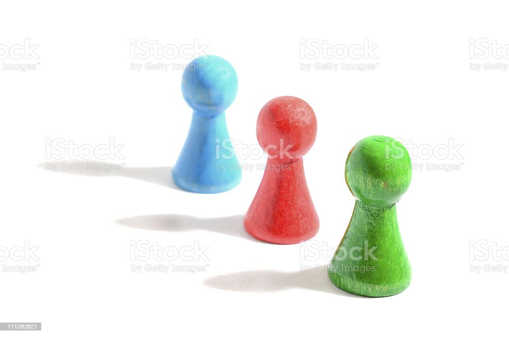 Board game pieces casting long shadow on white background stock photo