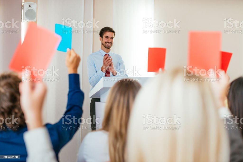 Board members voting for new management stock photo
