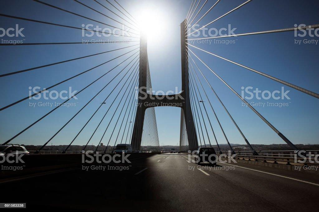 Board of the Vasco da Gama bridge of the lisbon portugal range with sun stock photo