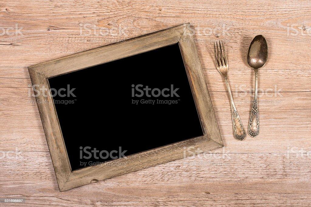 Board Mit Rahmen Aus Holz Und Gabel Und Löffel Stockfoto 531698897 ...