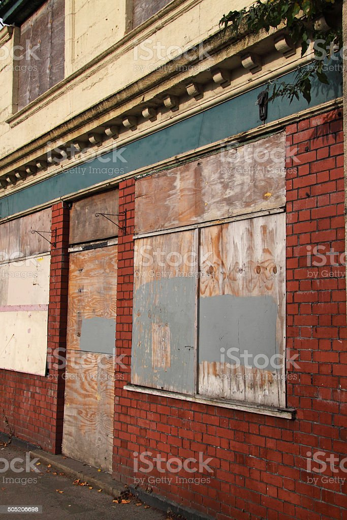 Boarded condemned tavern building in an inner city UK stock photo