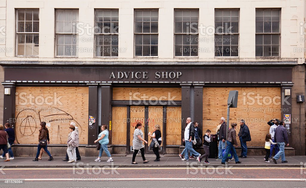 Boarded up shop in a busy Edinburgh street stock photo