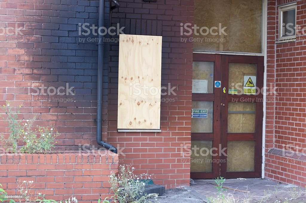 Boarded up Windows stock photo
