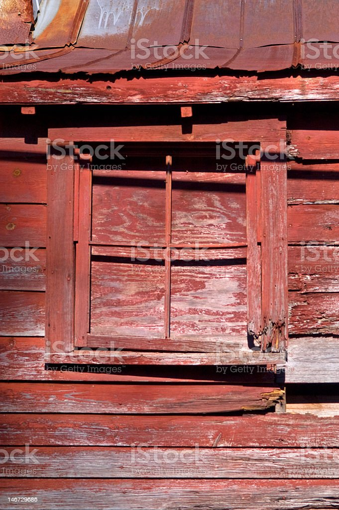 Boarded Window on Red Building royalty-free stock photo