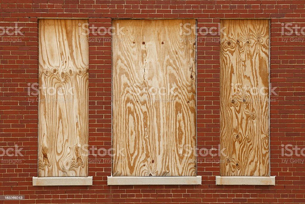 Boarded windows in abandoned building stock photo