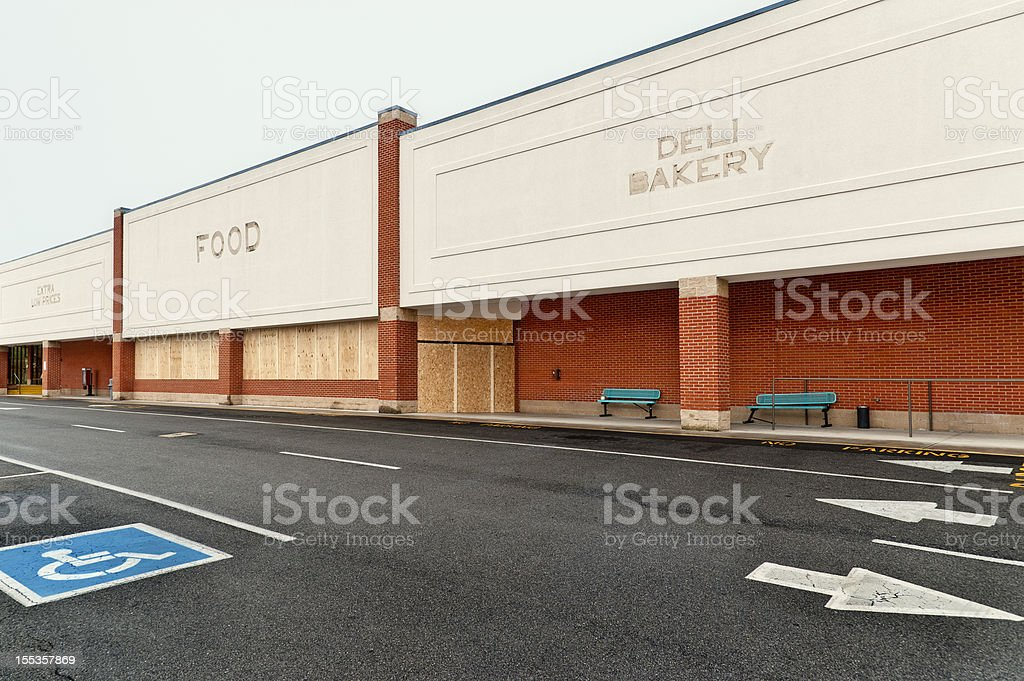 Boarded-up Out of Business Grocery Store royalty-free stock photo