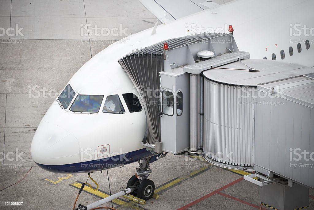Boarding a commercial airplane, air bridge attached stock photo
