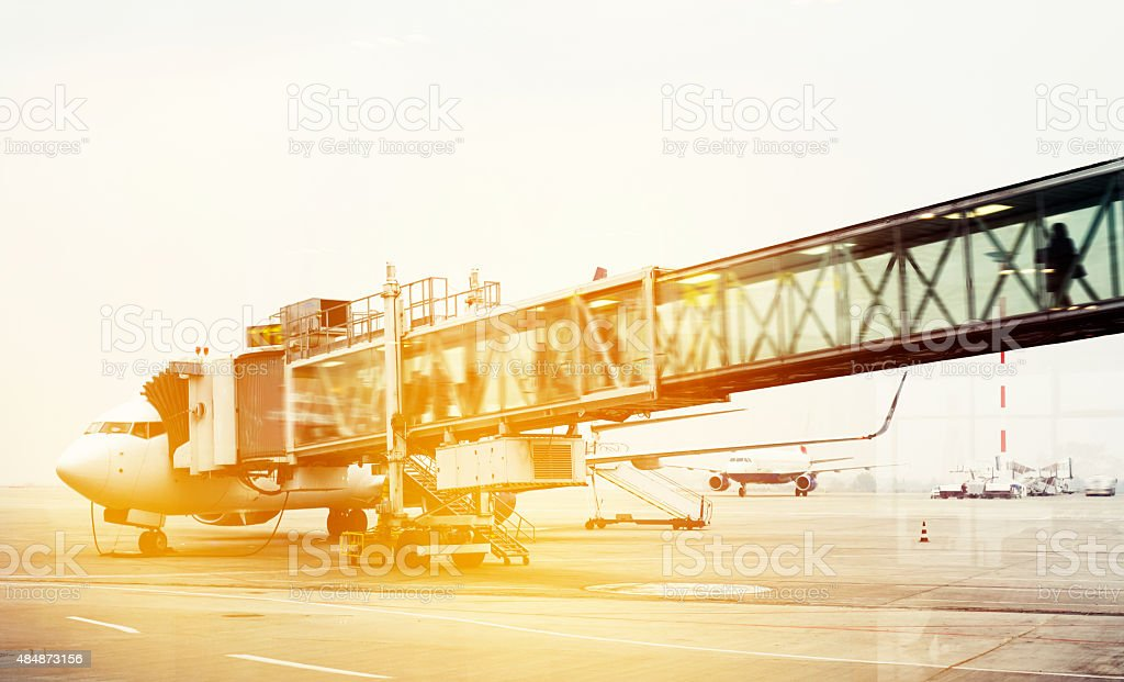 boarding in airplane stock photo