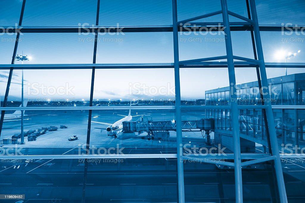 Boarding plane at night royalty-free stock photo