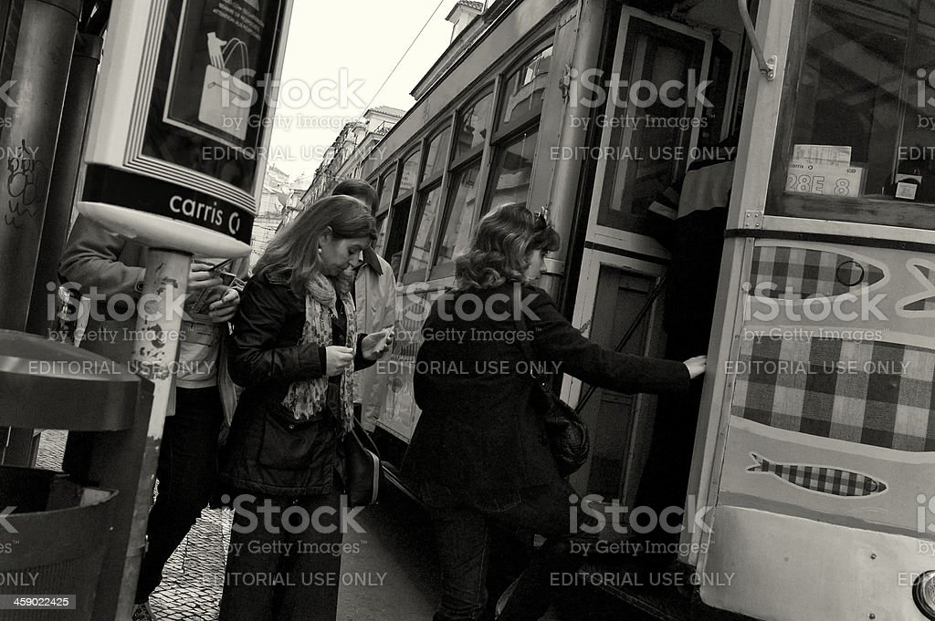 Boarding the Tram in Lisbon royalty-free stock photo