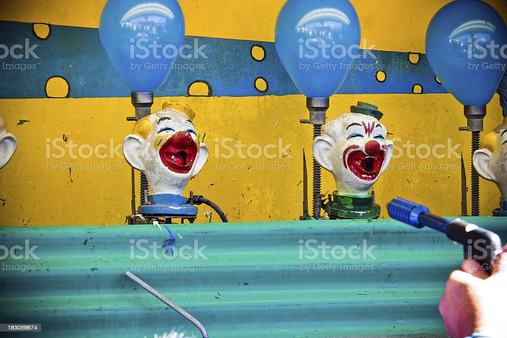 Boardwalk Game, spray water at the clowns stock photo