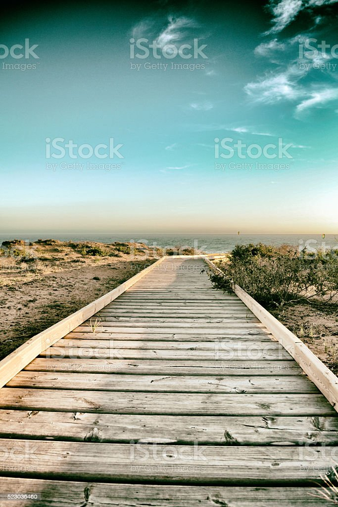 Boardwalk in the beach background stock photo