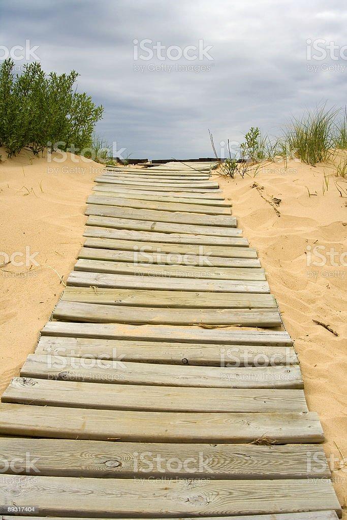 boardwalk in the sand stock photo