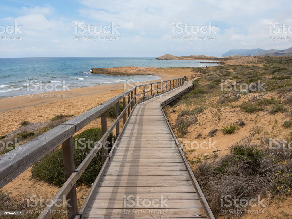 Boardwalk leading to Calblanque Nature Reserve, Murcia, Spain stock photo