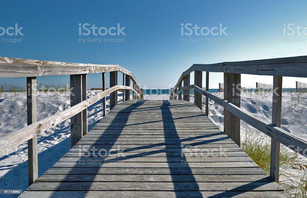 Boardwalk leading to the beach stock photo