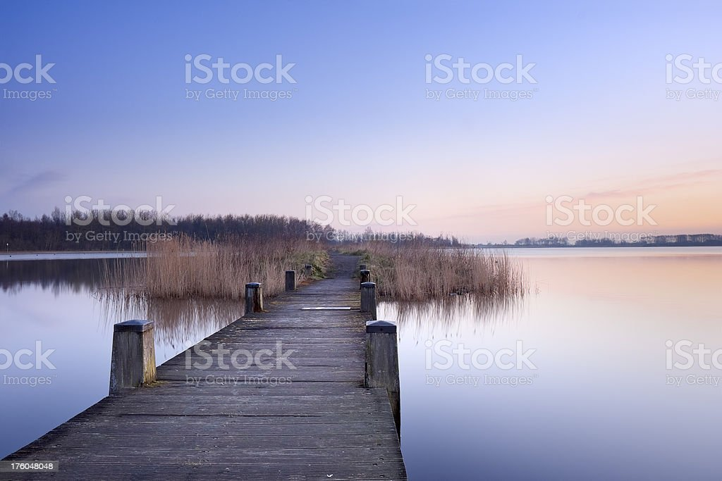 Boardwalk on a lake at dawn in The Netherlands royalty-free stock photo