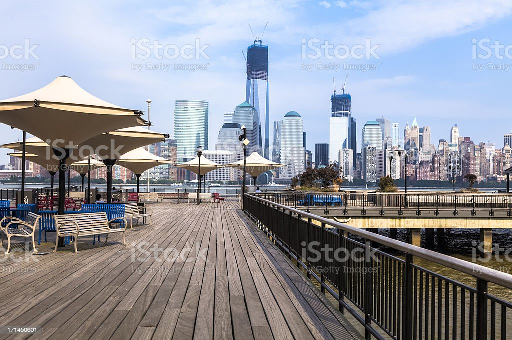 Boardwalk on Hudson River with Manhattan in background stock photo