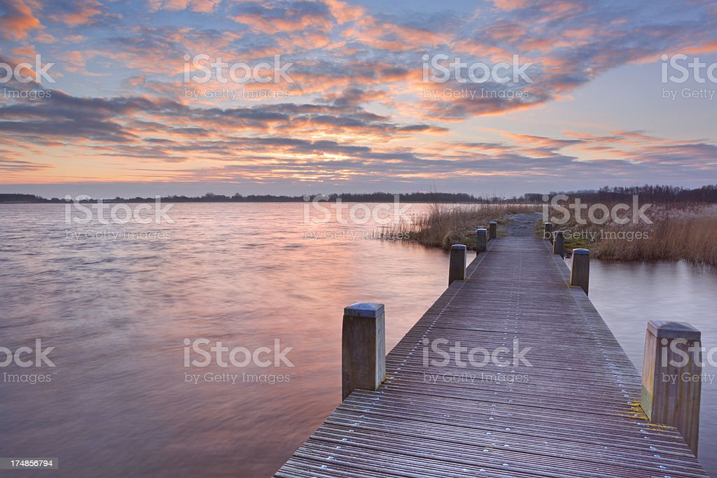 Boardwalk over water at sunrise, near Amsterdam The Netherlands royalty-free stock photo