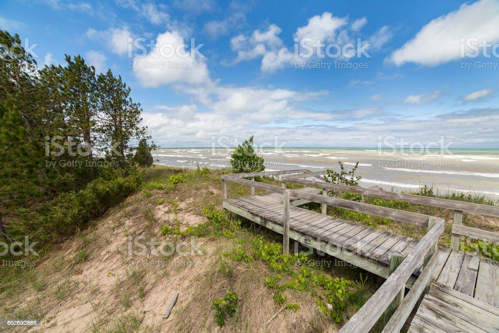 Boardwalk through a sand dune ecosystem next to Lake Huron stock photo