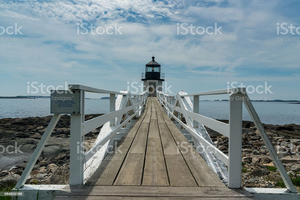 Boardwalk to Ocean Lighthouse stock photo