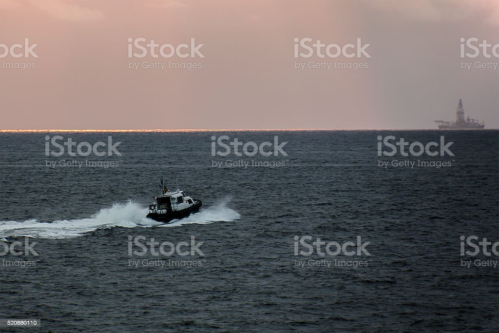 boat against the sea on the oil rig stock photo